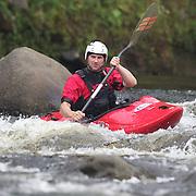 Canoeists paddling on The Waiwhakaiho River, New Plymouth, Taranaki with Outdoor Adventures. Taranaki has many beautiful rivers that flow from Mount Taranaki.  New Zealand.17th December 2010. Photo Tim Clayton