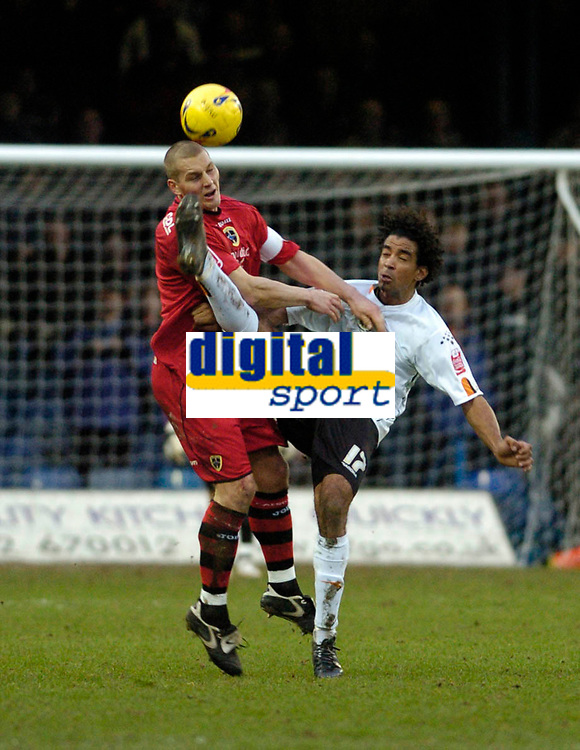 Photo: Leigh Quinnell.<br /> Luton Town v Cardiff City. Coca Cola Championship. 01/01/2007. Cardiffs Darren Purse clashes with Lutons Richard Langley.