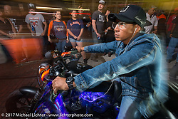 Riding down the Strand at night during the Lone Star Rally. Galveston, TX. USA. Friday November 3, 2017. Photography ©2017 Michael Lichter.