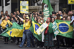 October 7, 2018 - London, United Kingdom - Supporters of far-right candidate Jair Bolsonaro demonstrate as Brazilians in London queue to cast their vote at the Embassy of Brazil near Trafalgar Square, in the Brazilian Presidential elections. Far-right candidate Bolsonaro is the front runner. (Credit Image: © Stephen Chung/London News Pictures via ZUMA Wire)