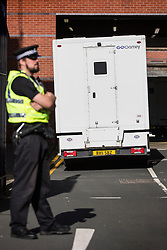 © Licensed to London News Pictures. 10/07/2015. Leeds, UK. Zdenko Turtak arrives with police protection at Leeds mags court this morning to be charged with the attempted murder and rape of a 18 year old woman in the Beeston area of Leeds on March 6th. Turtak was extradited back to the UK last night by officers from West Yorkshire Police Homicide and Major Enquiry Team.<br /> He was flown from the Slovakian capital Bratislava, where he had been held following his arrest at his home on June 4. Photo credit : Andrew McCaren/LNP