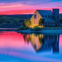Abandoned Old Stone Church in West Boylston of Central Massachusetts on a beautiful spring evening at sunset. New England sunset colors beautifully framed this historic landmark while church and sky colors reflecting in the Wachusetts Reservoir. <br />