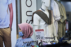 A salesgirl seen wearing mask while working at the Ramayana shooping centre in Medan, Indonesia on April 19, 2020 amid Corona Virus Disease-19 (DOVID-19) outbreak. The Indonesian government urges the nation to maintained the new health protocols in daily life as the physical and social distance during carrying out economic activities amid the COVID-19 outbreak and towards the holy Ramadan. Photo by Sutanta Aditya/ABACAPRESS.COM