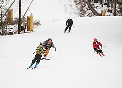 Members of Laconia High School's ski team make their way down the mountain during practice at Gunstock on Thursday, December 20, 2012.  (Alan MacRae/for the Laconia Daily Sun)