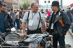 Kevin Waters chats with spectators as they check out the rolling motorcycle museum that is the Cannonball in Cape Girardeau during the Motorcycle Cannonball Race of the Century. Stage-5 from Bloomington, IN to Cape Girardeau, MO. USA. Wednesday September 14, 2016. Photography ©2016 Michael Lichter.