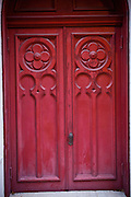 Old red wooden church door in Savannah, Georgia, USA.