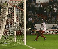 Photo: Mark Stephenson.<br /> Walsall v Aston Villa. Pre Season Friendly. 07/08/2007.Walsall's Paul Hall beats Villa's keeper David Bevan  for 1-1