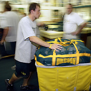 Oregon Ducks football team prepares for trip and travels to Oklahoma for game against against the Sooners. Staff load the players equipment onto trucks...Photos © Todd Bigelow/Aurora