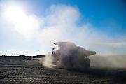 Earth mover making dust clouds at Vunene Coal mine