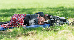 © Licensed to London News Pictures. 24/06/2015. Pilton, UK.   Festival goers Glastonbury Festival relax in the morning sun in front of the Pyramid Stage shortly after entering the site at 8am on  Wednesday Day 1 of the festival.        The pedestrian gates to the festival opened at 8am this morning, with many festival goers arriving and waiting throughout last night for the opening.  This years headline acts include Kanye West, The Who and Florence and the Machine, the latter having been upgraded in the bill to replace original headline act Foo Fighters.  Photo credit: Richard Isaac/LNP