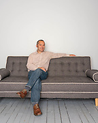 Portrait of business man sittiong on couch spaced to add text