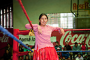 Alicia Flores female wrestler in the ring, crowd in background. Lucha Libre wrestling origniated in Mexico, but is popular in other latin Amercian countries, including in La Paz / El Alto, Bolivia. Male and female fighters participate in the theatrical staged fights to an adoring crowd of locals and foreigners alike.