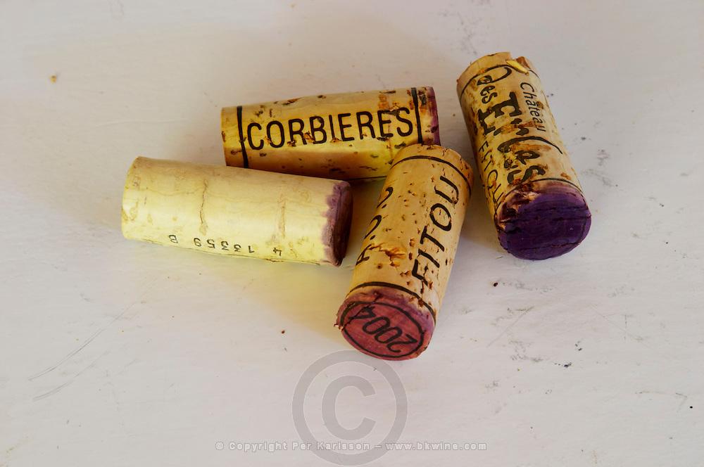 Corks: Corbieres, Fitou, 2004. Chateau des Erles. In Villeneuve-les-Corbieres. Fitou. Languedoc. Handful of corks on a table. France. Europe.