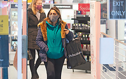 © Licensed to London News Pictures. 02/12/2020. <br /> Gravesend, UK. Shoppers leaving Debenhams in Gravesend, Kent after grabbing a bargain as lockdown ends and Kent move into tier three. Debenhams has lost JD Sports as a buyer and is going into administration. The high street giant has opened its doors today to begin a fire sale before all 124 UK stores close. Photo credit:Grant Falvey/LNP