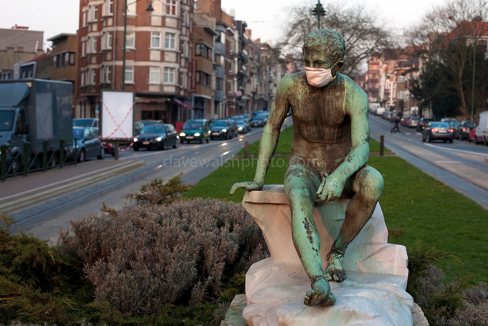 Statue wearing mask as protection against pollution, on Avenue du Parc, Brussels. This picture was made in March 2012. Mask placed on statue by unknown person.