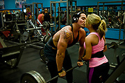 William DeShazer/Staff<br /> Rafael Denis, middle, of Bonita Springs, gets a good luck kiss from his fiance, Sarah Blondin, before moving on to the next set of weights in his leg workout routine at New Image Fitness in Bonita Springs on Thursday April 11, 2013. Denis proposed to Blondin at a bodybuilder competition.