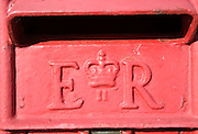 Close of detail red pillar Royal mail post box dating from Queen Elizabeth the Second's reign, UK