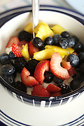 An über-healthy breakfast of strawberries, blueberries, blackberries, peaches and cottage cheese.