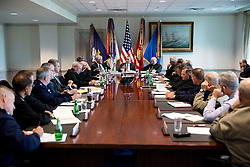 President Barack Obama meets with senior military leadership at the Pentagon in Arlington, Virginia, Oct. 8, 2014. Seated next to the President are Defense Secretary Chuck Hagel and Gen. Martin Dempsey, Chairman of the Joint Chiefs of Staff, right. (Official White House Photo by Pete Souza)<br /> <br /> This official White House photograph is being made available only for publication by news organizations and/or for personal use printing by the subject(s) of the photograph. The photograph may not be manipulated in any way and may not be used in commercial or political materials, advertisements, emails, products, promotions that in any way suggests approval or endorsement of the President, the First Family, or the White House.