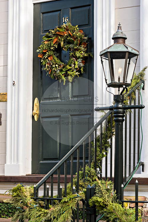 A historic home decorated with a Christmas wreath on King Street in Charleston, SC.