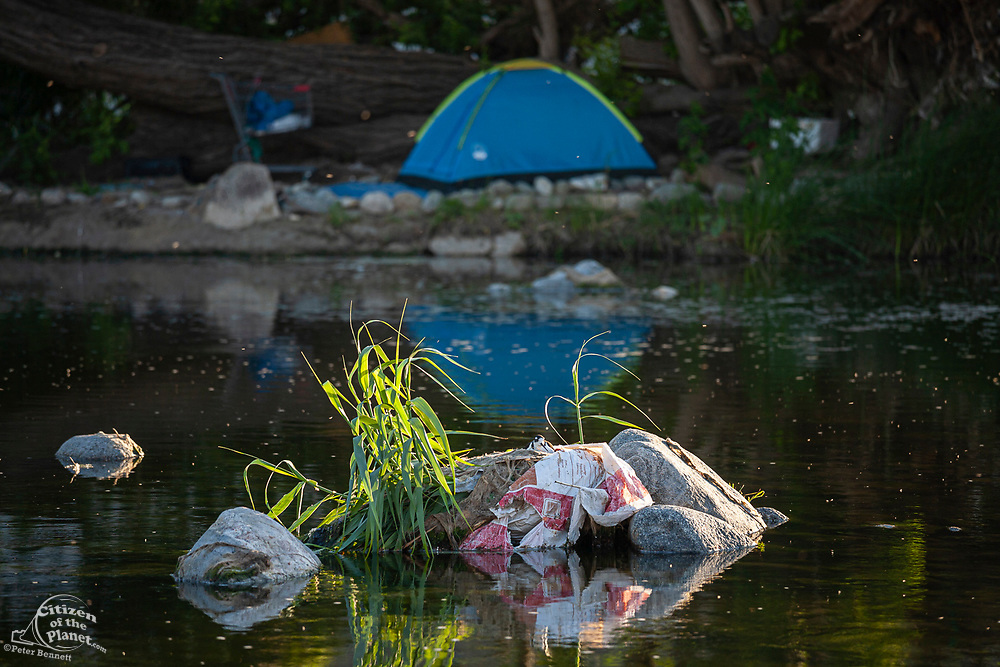 Homeless camp along Los Angeles River, Glendale Narrows, Los Angeles, California, USA