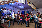 Dancing and live music with Chancey Williams and the Younger Brothers Band a the Buckin' A Saloon at Cheyenne Frontier Days Rodeo in Cheyenne, Wyoming.
