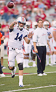 Auburn quarterback Barrett Trotter (14) makes a pass as head coach Gene Chizik watches before the start of an NCAA college football game against Arkansas on Saturday, Oct. 8, 2011, in Fayetteville, Ark. (AP Photo/Beth Hall)