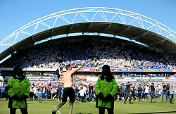 Fans invade the pitch at the end of the match