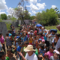 Aug 12, 2010 - Reynosa, Mexico - DIANNE HURMAN wades through a group of residents and their children waiting for food from the Frank Ferree Border Relief group in the colonia of Satelite Uno..(Credit Image: © Josh Bachman/ZUMA Press)