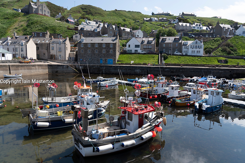 View  fishing boats in harbour at historic village of Gardenstown on Moray firth Coast in Aberdeenshire, Scotland, Uk
