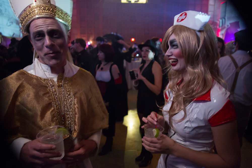 A man costumed as a Pope with a woman costumed as a nurse.