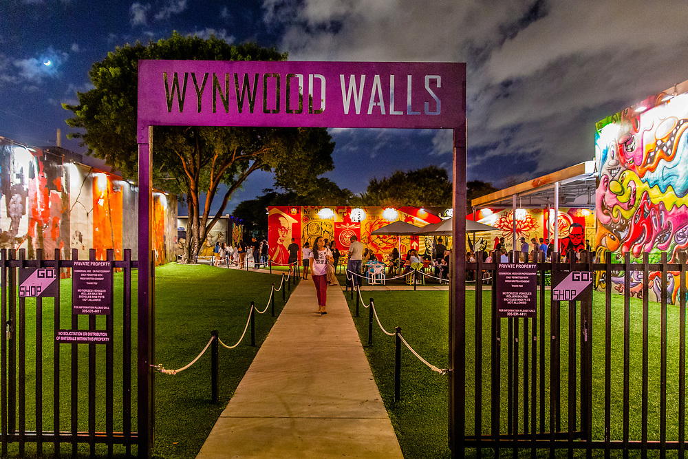 Entrance to Miami's Wynwood Walls outdoor street art museum at twilight