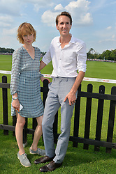 OTIS FERRY and EDIE CAMPBELL at the Audi International Polo at Guards Polo Club, Windsor Great Park, Egham, Surrey on 26th July 2014.
