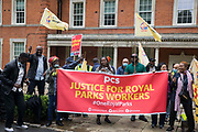 Royal Parks workers outsourced via French multinational VINCI Facilities attend a picket outside the Old Police House in Hyde Park as part of joint strike action by the United Voices of the World UVW and Public and Commercial Services PCS trade unions on 30th July 2021 in London, United Kingdom. The joint strike, with members dual carding over pay, conditions and the sacking of a member of staff, is believed to be the first between a TUC and a non-TUC trade union and follows the launch of a legal challenge by the Royal Parks workers against indirect racial discrimination by the Royal Parks.