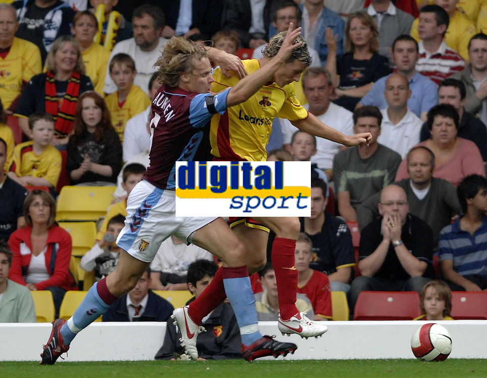 Photo: Richard Lane.<br />Watford v Aston Villa. The Barclays Premiership. 16/09/2006. <br />Watford's Darius Henderson is challenged by Villa's Martin Laursen.