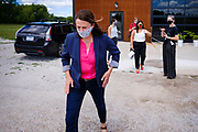"""22 JULY 2020 - AMES, IOWA: THERESA GREENFIELD walks back to her car after a visit to Alluvial Brewing in Ames, IA. Greenfield, a Democrat, is running for the US Senate against incumbent Republican Senator Joni Ernst. Recent polls have Greenfield slightly ahead of or statistically tied with Ernst, who is closely allied with President Donald Trump. Although Greenfield is not doing much in person campaigning with big events, she is meeting with business people across the state of Iowa to promote her """"Small Towns, Bigger Paychecks"""" economic program.         PHOTO BY JACK KURTZ"""