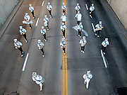 The Grand Island Central Catholic marching band makes its way down Eddy Street during the Harvest of Harmony Parade in Grand Island on Saturday. (Independent/Crystal LoGiudice).