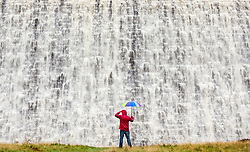 © Licensed to London News Pictures. 07/10/2019. Derwent Valley UK. Water from Derwent Reservoir cascades down Derwent Dam in the Upper Derwent Valley this morning after heavy rain fall in Derbyshire. The Dam was used by RAF 617 Squadron in 1943 for practising the low level bombing runs in Lancaster bombers needed for the Dam Buster raids. Photo credit: Andrew McCaren/LNP