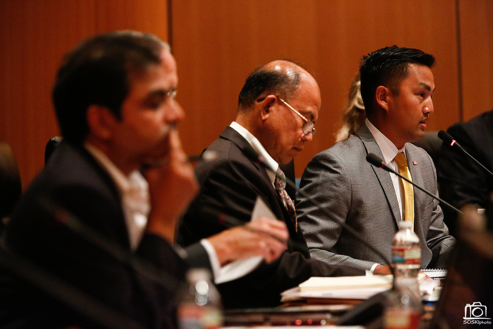 Richard Tran, right, discusses his Family Friendly approach during the Milpitas City Council Forum at Milpitas City Hall in Milpitas, California, on October 9, 2014. (Stan Olszewski/SOSKIphoto)