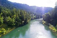 Paddling a canoe on the Middle Fork of the Willamette River near Oakridge, Oregon.