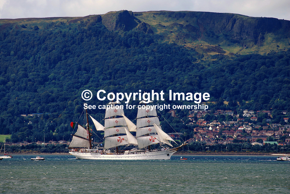 Portugal-registered, Sagres, a 3-masted barque departs Belfast, N Ireland, UK, at the end of the Belfast Maritime Festival in August 2009. It is sailing  down Belfast Lough with the Cave Hill, Co Antrim, in the background. 200908163003.<br /> <br /> Copyright Image from Victor Patterson, Belfast, UK<br /> <br /> t: +44 28 9066 1296 (from Rep of Ireland 048 9066 1296)<br /> m: +44 7802 353836<br /> e: victorpattersonbelfast@gmail.com<br /> <br /> www.images4media.com<br /> <br /> Please see my full Terms and Conditions of Use at https://www.images4media.com/p/terms-conditions - it is IMPORTANT that you familiarise yourself with them.<br /> <br /> Images used online incur an additional cost. This cost should be agreed in writing in advance. Online images must be visibly watermarked i.e. © Victor Patterson or that of the named photographer within the body of the image. The original metadata must not be deleted from images used online.<br /> <br /> This image is only available for the use of the download recipient i.e. television station, newspaper, magazine, book publisher, etc, and must not be passed on to a third party. It is also downloaded on condition that each and every usage is notified within 7 days to victorpattersonbelfast@gmail.com.