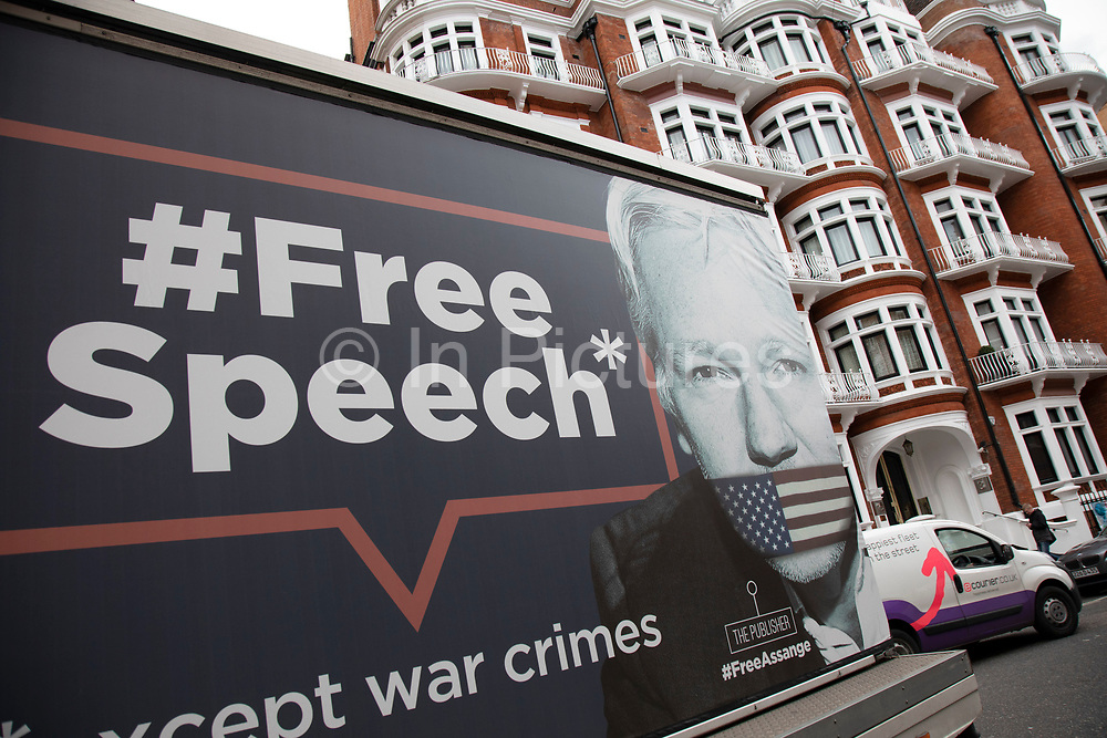 Billboard depicting the words Free Speech and a gagged Wikileaks founder Julian Assange outside the Ecuadorian Embassy on 5th April 2019 in London, England, United Kingdom. Their presence comes as Wikileaks has announced that their founder Julian Assange may be expelled from the Embassy within hours or days.