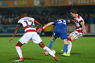 AFC Wimbledon midfielder Callum Reilly (33) battles for possession with Doncaster Rovers midfielder Ben Sheaf (6) during the The FA Cup match between AFC Wimbledon and Doncaster Rovers at the Cherry Red Records Stadium, Kingston, England on 9 November 2019.