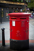 Typical red mailbox in the city of London