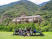 A group of hikers takes a break along the Camino Salkantay, Peru.