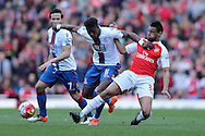 Francis Coquelin of Arsenal tackles Wilfried Zaha of Crystal Palace. Barclays Premier league match, Arsenal v Crystal Palace at the Emirates Stadium in London on Sunday 17th April 2016.<br /> pic by John Patrick Fletcher, Andrew Orchard sports photography.
