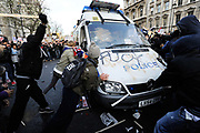 Attacking a police riot van. National student demonstration in London, protesting against tuition fees and the threat of top-up fees. Students from all over the UK gathered in central London for a second mass demo in protest of the coalition govenrnment's plans for education funding. Centred around Whitehall the protest was partly peaceful but also marred by arrests and some violence.