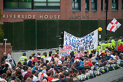 """Rotherham England<br /> 13 September 2014 <br /> EDL supporters approach Rotherham Councils offices Riverside House during a march from Rotherham Town Hall  to Rotherham Main Street Police station where they held a rally as part of the English Defence Leagues """"Justice for the Rotherham 1400"""" March described by an EDL Facebook Page as """"a protest against the Pakistani Muslim grooming gangs"""" on Saturday Afternoon <br /> <br /> <br /> Image © Paul David Drabble <br /> www.pauldaviddrabble.co.uk"""