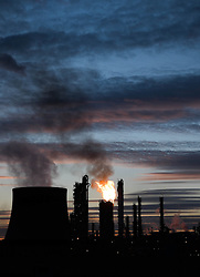 © Licensed to London News Pictures. <br /> 04/03/2015. <br /> <br /> Wilton, United Kingdom<br /> <br /> Dramatic flaring from the chemical works on Teesside lights up the evening sky as an amazing sunset lights up the clouds in the distance. The flaring from the site forms an essential part of the safety systems at the plant and present no danger to the public.<br /> <br /> Photo credit : Ian Forsyth/LNP