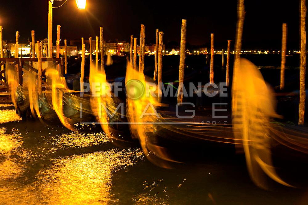 Gondolas moored at mooring poles Piazza San Marco Venice Italy